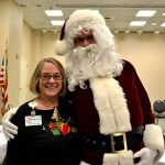 Santa poses with a Grace Ridge employee