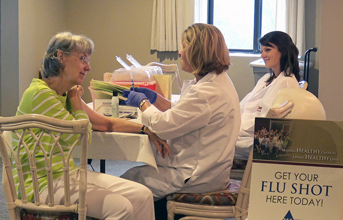 Resident getting flu shot at Wellness Fair